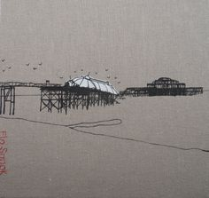 20x20cm textile of West Pier in Brighton, on linen fabric stretched over a wooden frame. Silk screen with applique and hand stitching. By Flo Snook