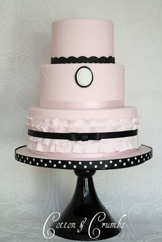 I love this because the cake it self is so simple and elegant. When you really look at it, what makes the cake, is the cake stand! Loves that