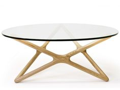 """Aeon Starlight Coffee Table Ash - Classically designed by Sean Dix, Aeon's Starlight coffee table boasts a six-pointed star frame crafted from solid American Ash natural color with a 1/2″ thick tempered glass top. The Starlight coffee table is sure to add an element of sophistication to any room in your home or office and is certain to shine throughout the day and night. Dimensions: 39.50""""w x 39.50""""d x 16.25""""h"""