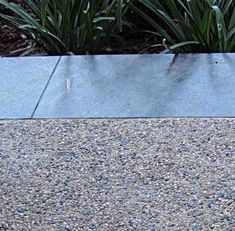Exposed Aggregate With Large Blue Stone Coping