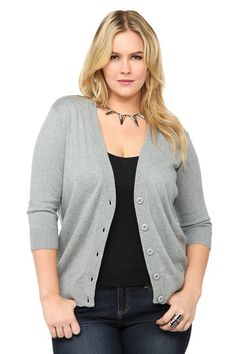 A deep V-neck defines a soft, basic cardi that's destined to become a key piece for your on-trend layering this season. Features ribbed trim, 3/4 sleeves and tonal buttons.