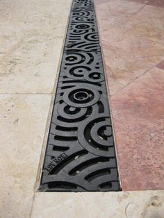 Iron Age Designs Oblio trench drain grate  and this is the winner!