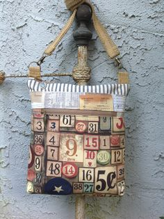 Barbados Bag finished today with Tim Holtz's new fabric line along with vintage ticking and upholstery webbing.