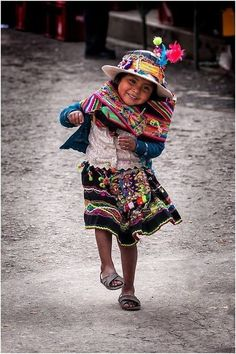 This Peruvian girl inspires me to do a lesson showing images of children around the world showing similarities and differences.  Keeping it simple the images would be impressive by themselves to even preschoolers.