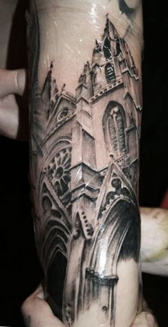 This black and grey tattoo of a Gothic cathedral was inked by Samuel Potucek.