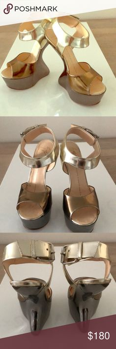 Giuseppe Zanotti Heel Less platform heels Guaranteed to make you the center of attention. These heel less heels are surprisingly comfortable and will have everyone asking about your shoes. Minor scuffs at the heels, great condition. Giuseppe Zanotti Shoes Platforms