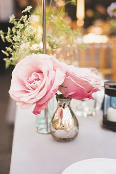 #roses, #centerpiece  Photography: Rebecca Hansen Weddings - rebeccahansenweddings.com Event Planning: The Boutique Group - theboutiquegroup.com/ Floral Design: The Designer\'s Co-op - thedesignersco-op.com/  Read More: http://stylemepretty.com/2013/04/29/new-york-city-wedding-from-rebecca-hansen-weddings/
