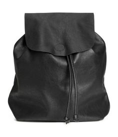 Black. Backpack in grained imitation leather with narrow adjustable shoulder…