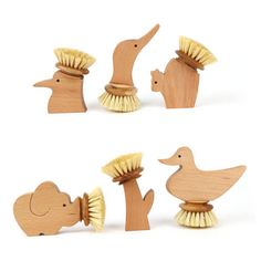 Legnomagia's Oasi - a series of dishwashing brushes in six different shapes – elephant, hoopoe, goose, duck, squirrel, and a flower. Made from natural beech wood and plant fibre.