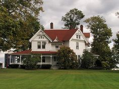 White farm house.  I just love the big house and the porch!!