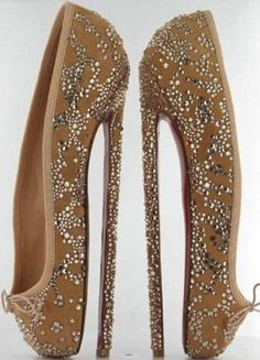 Insane eight inch designer heels by Christian Louboutin to auction off for the English National Ballet's fundraiser. The one-of-a-kind pumps are inspired by ballet shoes and covered in lots of drool worthy Swarovski crystals.