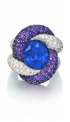 A SAPPHIRE, AMETHYST AND DIAMOND RING, BY JAR The entwined diamond and amethyst…