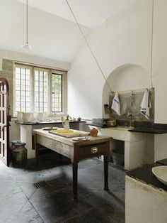 The Dairy Scullery at Lanhydrock, Cornwall. Milk was brought from the Home Farm to the Dairy Scullery to make butter and cream. Kitchen Rug, Old Kitchen, Rustic Kitchen, Country Kitchen, Kitchen Interior, Georgian Interiors, Victorian Kitchen, Rustic Restaurant, Home Kitchens