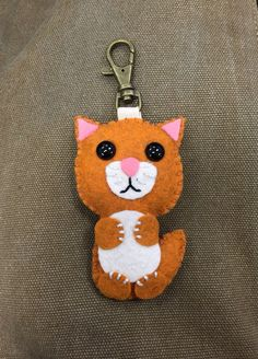 A personal favorite from my Etsy shop https://www.etsy.com/listing/222235535/handmade-felt-cat-ornament-orange