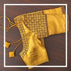 Elegant Kundhan and thread embroidery stands out against the delicate and playful yellow of this blouse. Get yours customized today by… Cutwork Blouse Designs, Kids Blouse Designs, Wedding Saree Blouse Designs, Simple Blouse Designs, Blouse Back Neck Designs, Stylish Blouse Design, Hand Designs, Cut Work Blouse, Hand Work Blouse Design