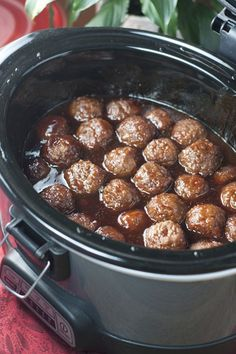 Crock Pot Grape Jelly BBQ Cocktail Meatballs are an awesome recipe for holiday entertaining, Super Bowl party, or pot luck made right in the slow cooker. They are so simple to make and extremely crowd-pleasing! @wishesndishes