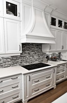 Love the glass tile backsplash and the little side cupboards (great for baking sheets).