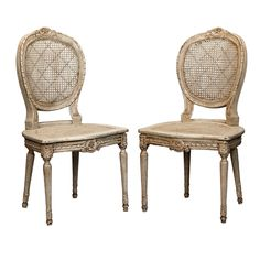 Six French Painted and Caned Oval Back Chairs