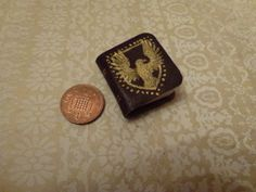 Nov Tiny Handbound Leather Book featuring a Hogwarts Ravenclaw inspired design in gold. Probably to turn into a necklace at some point! By QueenHare for the Design Every Day Project Leather Books, Ravenclaw, Hogwarts, My Design, Design Inspiration, Inspired, Day, Projects, Gold