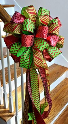 Check out this item in my Etsy shop https://www.etsy.com/listing/251539565/christmas-tree-topper-bow-holiday-deluxe