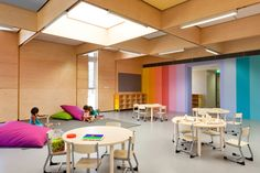 The award winning John Septimus Roe Anglican Community School (JSRACS) Beechboro Kindergarten designed by Brooking Design Architects features a play between natural light and energy efficient lights supplied by HALO Lighting. Kindergarten Interior, Kindergarten Design, Kindergarten Library, Classroom Decor Themes, School Decorations, Classroom Design, Seating Chart Classroom, Classroom Pictures, Preschool Colors