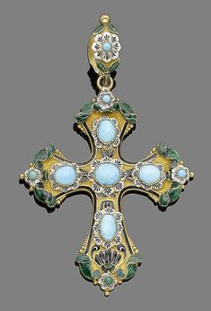 A turquoise and enamel cross pendant  The Gothic cross decorated throughout with floral details, and green, white and black enamel, highlighted with circular and oval cabochon turquoises, length 8.4cm