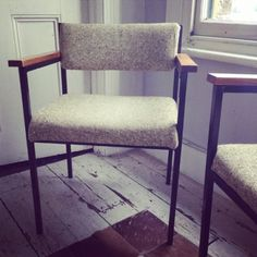 Modernist, mid century utility style, black steel framed chair with tweed upholstered seat and stylish wooden arms. Super stylish Mad Men chair. Perfect for hip offices or homes. Dimensions: H: 74 x Seat Height: 45 x W: 57 x D: 44 cm. UK delivery mainland only in 3-7 days.
