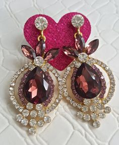 Fast Shipping using First Class Mail Most packages arrive in 2-5 business days!  Amazing sparkling Rhinestone Earrings  Perfect for formal occasions and holiday parties