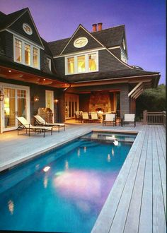 Built in above ground pool - doesn't look like above ground!  Love the porch also
