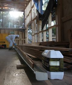 Applying a Boron coating to the timber cladding to satisfy the bushfire timber rating.
