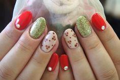 Red, green, beige nail design.
