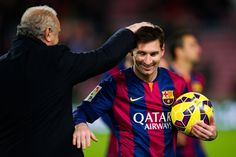 Lionel Messi of FC Barcelona is congratulated by his team's delegate Carles Naval after scoring three goals during the La Liga match between FC Barcelona and RCD Espanyol at Camp Nou on December 7, 2014 in Barcelona, Catalonia.