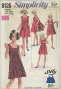 An original ca. 1969 Simplicity Pattern 8125.  Reversible Dress:  The dress without side seams has scoop neckline. Dress front is fastened in back with ribbon ties. Dress back fastens in front with self fabric tie ends above normal waistline.