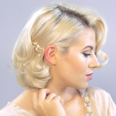 Exude elegance on your next formal in this vintage-inspired hairstyle with lustrous curls. Learn how to recreate this 'do through this detailed video tutorial.