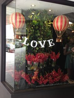 "Beautiful Blooms: Our ""Love"" Window. A Celebration For Valentines Day Window Display"