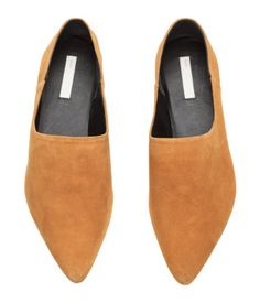 Camel. PREMIUM QUALITY. Soft slip-on shoes with pointed toes, leather lining, leather insoles, and rubber soles. Heel folds down so shoes can be worn as
