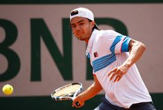 Taro Daniel Photos Photos - Taro Daniel of Japan plays a forehand during the mens singles first round match against Jerzy Janowicz of Polanand on day one of the 2017 French Open at Roland Garros on May 28, 2017 in Paris, France. - 2017 French Open - Day One