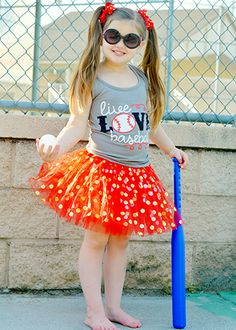 Girls tutu with gold polka dots. Each features 3 layers of soft tulle with gold polka dots and a satin covered elastic waistband.