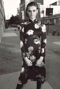 Cara Taylor wears Zara printed midi dress, over-the-knee boots and rhinestone fringe earrings
