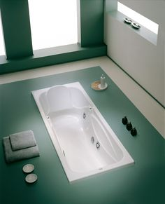 Bathtub to level of the floor.
