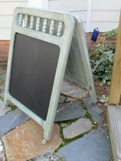 Repurpose an old baby crib with some hinges and chalkboard paint.