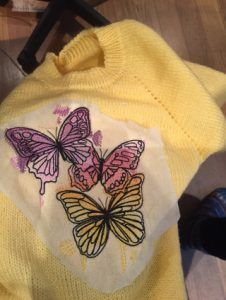 More machine embroidery on handmade sweaters. Adding a special touch to make it unique.