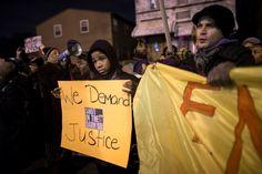 FILE - In this Nov. 22, 2014, file photo, demonstrators pause outside the 75th Police Precinct durin... - AP Photo/John Minchillo, File