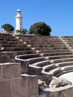 Ancient Roman Odeon Theatre with Paphos Lighthouse, Cyprus. Built in the 2nd century AD