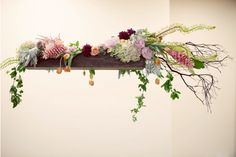 hanging arrangements... above a porch table? for a party or wedding? yes please.