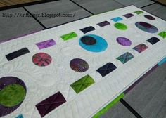I have a new pattern for sale in my Craftsy  shop! This Modern Circles table runner was designed using the gorgeous Island Batik  fab...
