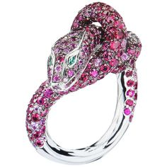 Boucheron Kaa Snake Sapphire Ruby Emerald Diamond Ring. This magnificent Serpent ring by famed designer Boucheron exudes adventure and class.  208 round rubies, 5,37 carats 73 pink round sapphires, 1,34 carats 11 black round diamonds, 0,11 carats 2 emeralds, 0,02 carats Blackened white gold 750/1000, 15,0g