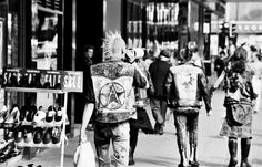 Punk Fashion - Punk styles emerged in the 1970s. Clothing was generally torn, ripped, and stained. Leather and metal accessories were common as was black makeup and fishnet stockings.