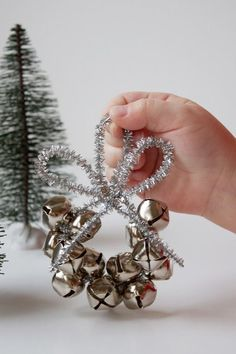 Jingle Bell Ornament bells + 2 pipe cleaners per ornament as shown) I would add a bead in between the bells. Diy Christmas Ornaments, Christmas Projects, Holiday Crafts, Holiday Fun, Christmas Decorations, Santa Ornaments, Jingle Bell Crafts, Jingle Bells, Preschool Christmas