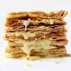 Napoleon Recipe, Mille-Fuilles, Milhojas This classic French pastry, whose name in both French (mille-feuilles) and Spanish (milhojas means thousand leaves, is also known as the Napoleon. Classic French Desserts, French Dessert Recipes, French Food, French Recipes, Dessert Simple, Napoleons Recipe, Cherry Clafoutis, French Pastries, Italian Pastries